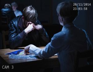 Broken man in interrogation room