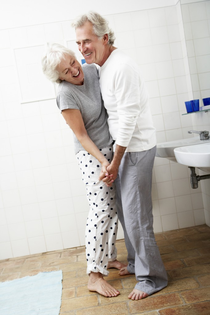 Romantic Senior Couple In Bathroom