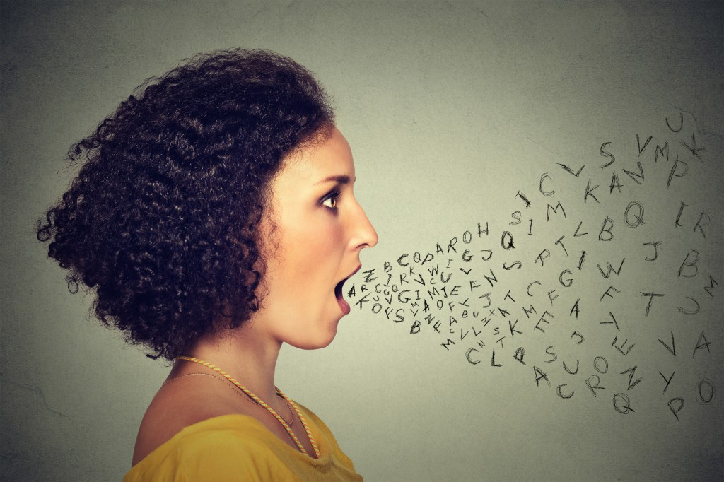 Woman talking with alphabet letters coming out of mouth
