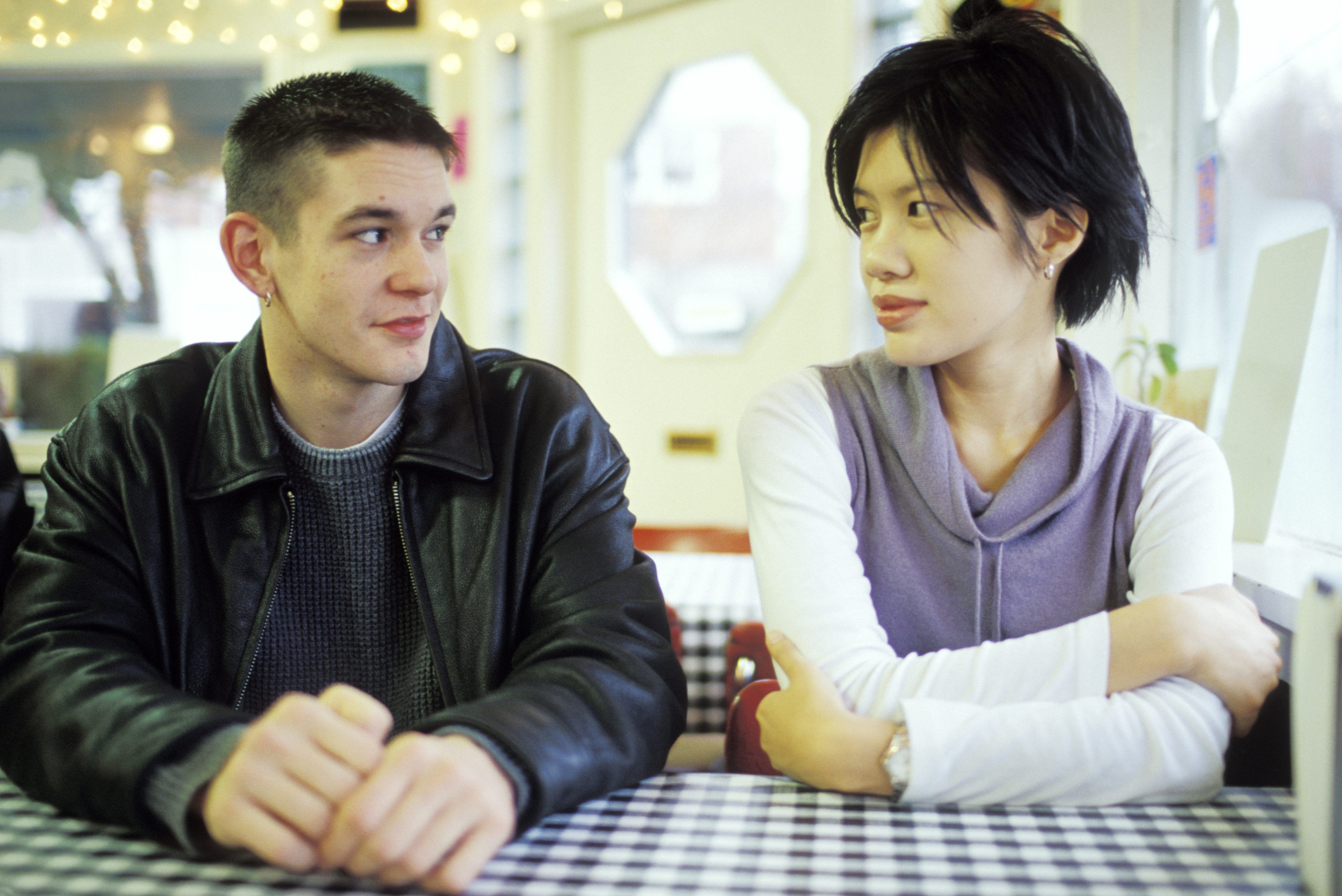 Man and Woman Talking at a Diner