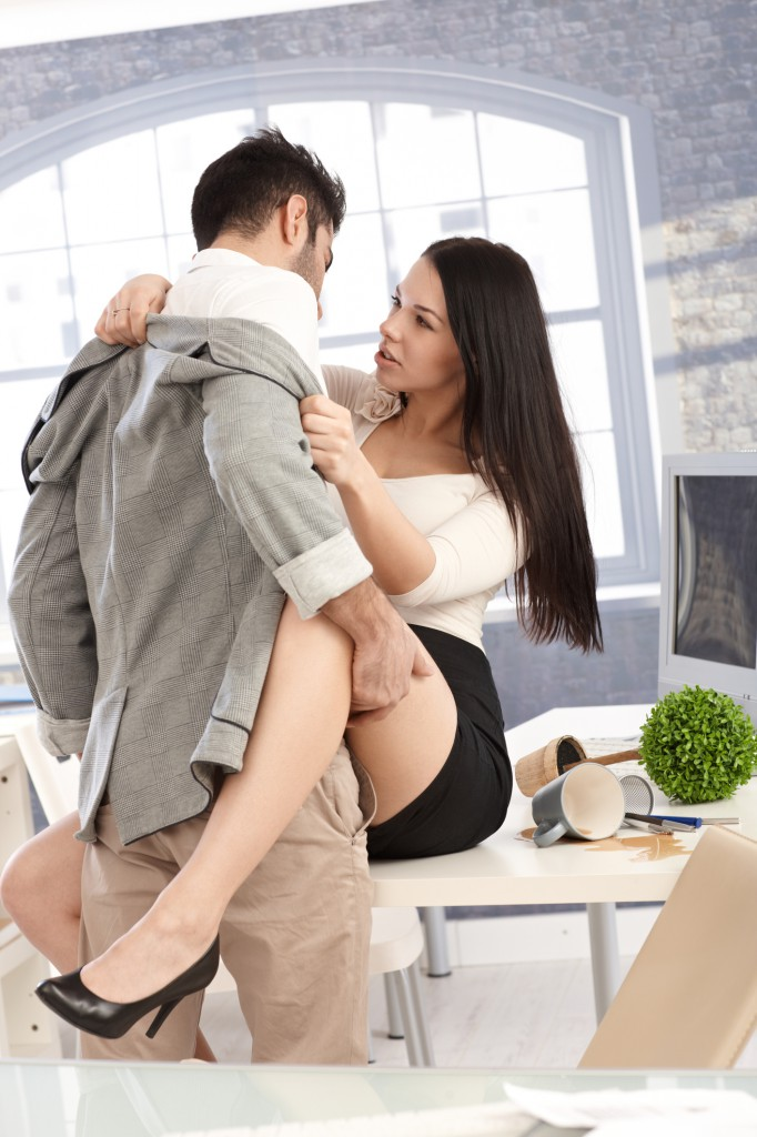Young couple having sex at workplace