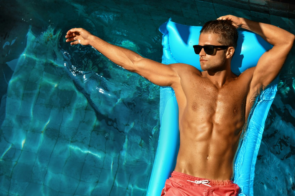Man Body In Summer. Male Relaxing In Pool On Vacation